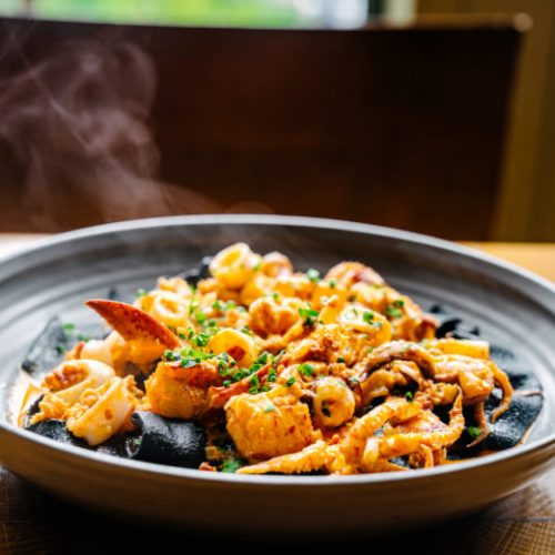 Squid-ink-pasta-in-Calabrian-chili-sauce-with-lobster-and-calamari